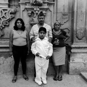 Tixtla, Guerrero, Mexico, May 24th, 2015: The family of Adan Abraj‡n de la Cruz posing for a family portrait after Angel's First Communion in Tixtla, Guerrero. Ad‡n was one of the 43 missing students from the Ayotzinapa Teacher's Rural School that went missing on the night of September 26, 2014 in Iguala. (L-R): Erica, Adan's wife and Angel's mother; Don BernabŽ, Adan's father and Angel,8, Adan's son; Do–a Delfina, Adan's mom. Tixtla, Guerrero, May, 2015 Photo © Adriana Zehbrauskas for BuzzFeedNews