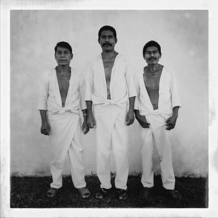 """Huehuetonoc, Guerrero, Mexico, Dec 2015: Don Marino, Don Juan and Don Angelo belong to the village's law enforcement committee. It was surprising to see that not only families wanted to be photographed. """"Family Matters"""", Huehuetonoc, Guerrero, Mexico, Dec 2015 Family Matters is a project born while I was working with the families of the 43 students from the Ayotzinapa teachers rural school that disappeared last year in Iguala. While working with them, I noticed that none of them had family photos - all they had were snapshots taken on their cell phones that were lost or accidentally deleted. Nobody printed any more pictures. It struck me that these people were not just denied a future with their loved ones, but they were also denied a past - with the lost photos, their memories would also eventually vanish. And who are we, without our memories? It's paradox to me that in this day and age, where the amount of images produced has never been greater and yet, nobody is keeping them anymore. How many will survive? And if they don't, what will happen to our history? Is life only a series of physical impulses that cease to have any meaning the moment they stop? A person photographed has achieved a moment of redemption, saved from the fate of being forever forgotten."""