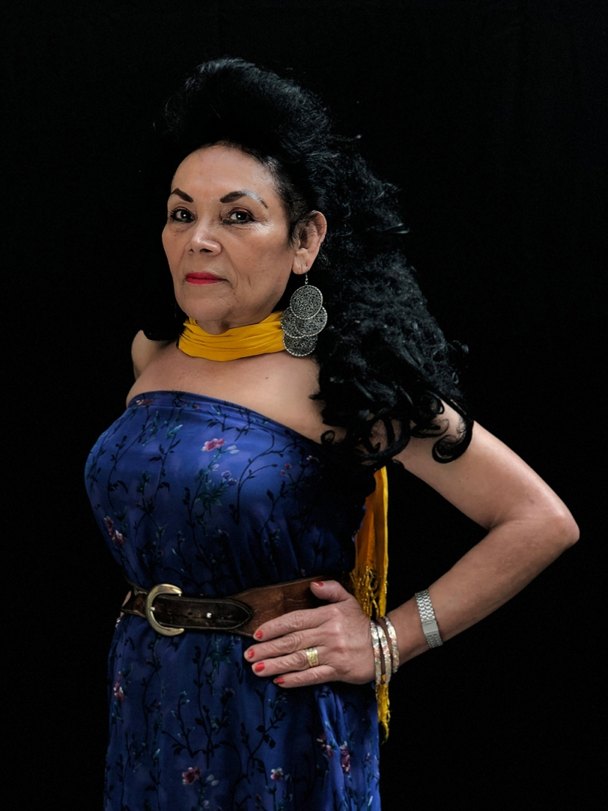 """Mexico City, Mexico, Dec 15th 2017: Norma Angélica Sánchez Garduza, 53, conocida como Angie, en su habitación en la Casa Xochiquetzal, un abrigo en la Ciudad de Mexico para sexo servidoras mayores rescatadas de la calle. Los vecinos la llaman Maria Felix, una alusión a la famosa actriz/cantante mexicana. Le encanta vestirse bien, siempre en caladas largas, tacones y una bufanda en el cuello. Lápiz labial color naranja, un poco manchado. Ella ha vivido en el abrigo por 5 años, pero sueña en regresar al su estado natal de Tabasco. """" Nunca más quiero regresar a la calle."""" dice. """"Es muy difícil. Pierdes tu dignidad como ser humano."""" Photo © Adriana Zehbrauskas para The New York Times Photo © Adriana Zehbrauskas for The New York Times"""