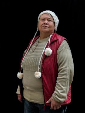"""Mexico City, Mexico, Dec 15th 2017: Maria Norma Ruiz Sánchez, 65 (Normota) posa para un retrato en la Casa Xochiquetzal, un abrigo en la Ciudad de Mexico para trabajadoras sexuales mayores rescatadas de la calle. Norma fue violada a los 9 cuando iba caminando de regreso a su casa de la escuela en el estado de Jalisco. Todavía se nota la cicatriz en su pierna izquierda de cuando le quitaron a la fuerza el uniforme. Huyó de casa a los 14 años para escapar de un hermano abusivo. Un camionero la llevó hasta San Francisco, donde pasó su cumpleaños 15 sola en una habitación rentada comiendo pollo y tomando cerveza. Poco tiempo después regresó a México. A los 16, tuvo al primero de sus cuatro hijos. Trabajó en el campo, fue dueña de un cabaret, en algún momento fue luchadora profesional y tuvo muchos amantes pero un solo amor. Intentó suicidarse en cuatro ocasiones; la última vez fue en una habitación de hotel en el Bar Nebraska, en las afueras de Guadalajara. A veces, Sánchez todavía va a su """"oficina"""", como le llama; es un parque en la estación del metro Hidalgo donde se mezclan los clientes nuevos con las memorias viejas. """"Estoy muy cansada, me duele todo"""", dijo. """"Hago bromas sobre mi vida para llevar el día a día, pero mi tristeza no tiene fin"""". Photo © Adriana Zehbrauskas para The New York Times"""
