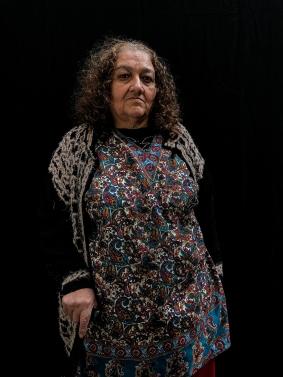 """Mexico City, Mexico, Dec 15th 2017: Maria Marbella Aguilar Sosa, 61, posa para un retrato en la Casa Xochiquetzal, un abrigo para trabajadoras sexuales rescatadas de la calle. """"No quiero hablar del pasado, solo olvidarlo"""". dice. """"Me encanta leer y escribir. Poesía, prosa, lo que sea. No puedo dormirme sin que estén mis libros aquí al lado"""". Entre sus favoritos menciona Los miserables, Lolita y las obras de Pablo Neruda y de Tolstoi. Pero ella misma podría llenar todo un libro con sus experiencias, pues su vida ha sido todo menos ordinaria. Y Casa Xochiquetzal no es cualquier hogar: es un albergue para trabajadoras sexuales retiradas o semijubiladas Photo © Adriana Zehbrauskas para The New York Times"""